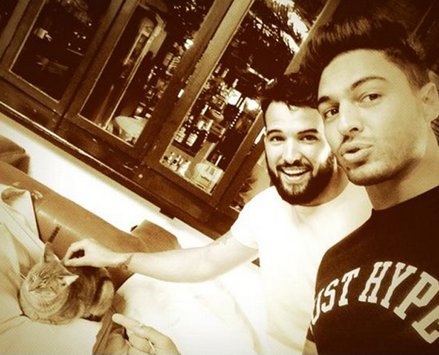 TOWIE in Ibiza: Mario Falcone and Ricky Rayment play with a cat