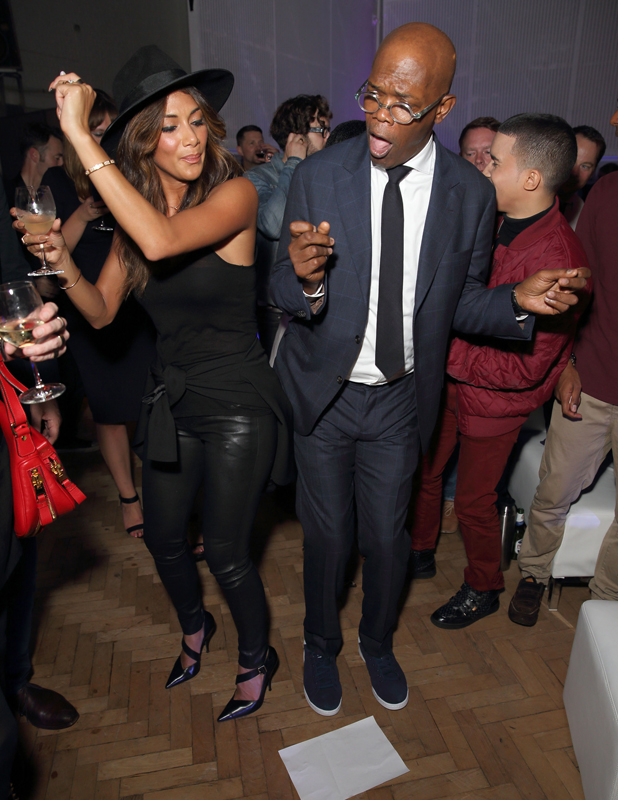 Nicole Scherzinger and Samuel L. Jackson dance at One For The Boys #SingOne4TheBoys Karaoke Night at Abbey Road Studios on September 25, 2014 in London, England.