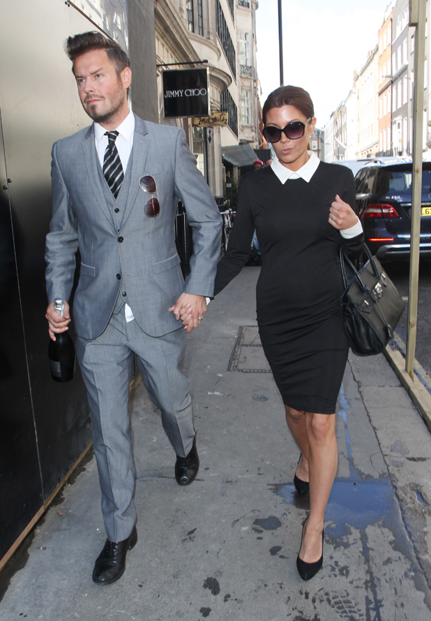 Victoria and David Beckham lookalikes seen arriving at Victoria Beckham's store on Dover street, the day before it's official opening, 24 September 2014
