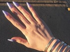 Kylie Jenner pairs pastel lilac manicure with super-expensive bracelets