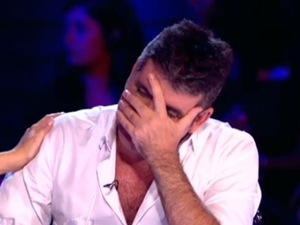 Simon Cowell covers his face after senfing Janet Grogan home during X Factor bootcamp. 28 September 2014.