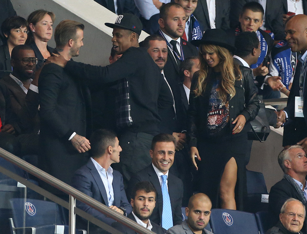 David Beckham, Jay Z and Beyonce attend the UEFA Champions League Group F match between Paris Saint-Germain FC and FC Barcelona at the Parc des Princes stadium on September 30, 2014 in Amsterdam, Netherlands.