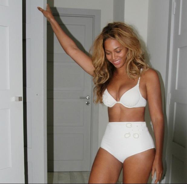Beyonce wears a white bikini in France - 1 Oct 2014