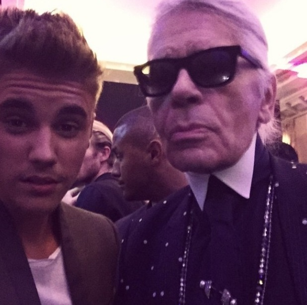 Justin Bieber takes selfie with fashion mogul Karl Lagerfeld at Paris Fashion Week - 30 September.