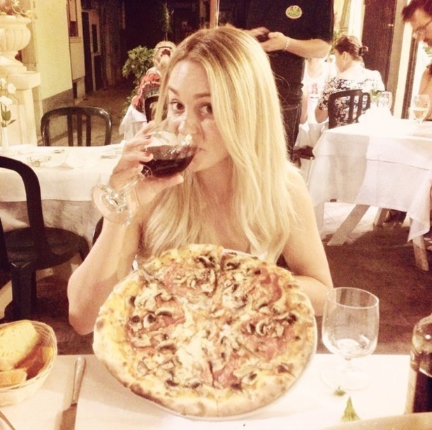 Lauren Conrad shares a photo from honeymoon of herself during dinner, Italy 27 September