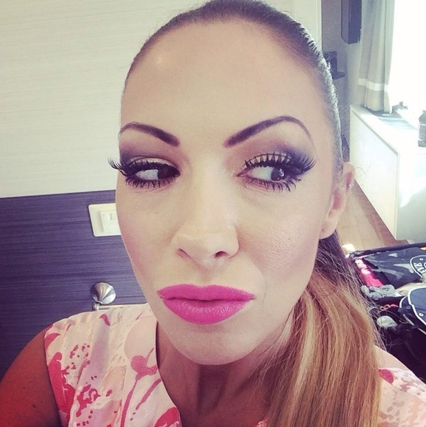 Jodie Marsh flaunts bright pink lipstick in a Twitter selfie - 28 September 2014