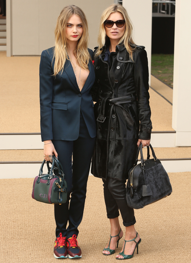 Cara Delevingne and Kate Moss at the Burberry show on 15 September 2014