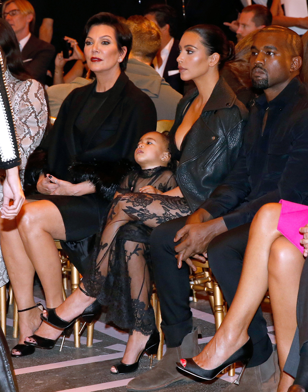 Kim Kardashian, Kris Jenner, Kim Kardashian, Kanye West and their daughter North West attend the Givenchy show as part of the Paris Fashion Week Womenswear Spring/Summer 2015 on September 28, 2014 in Paris, France.