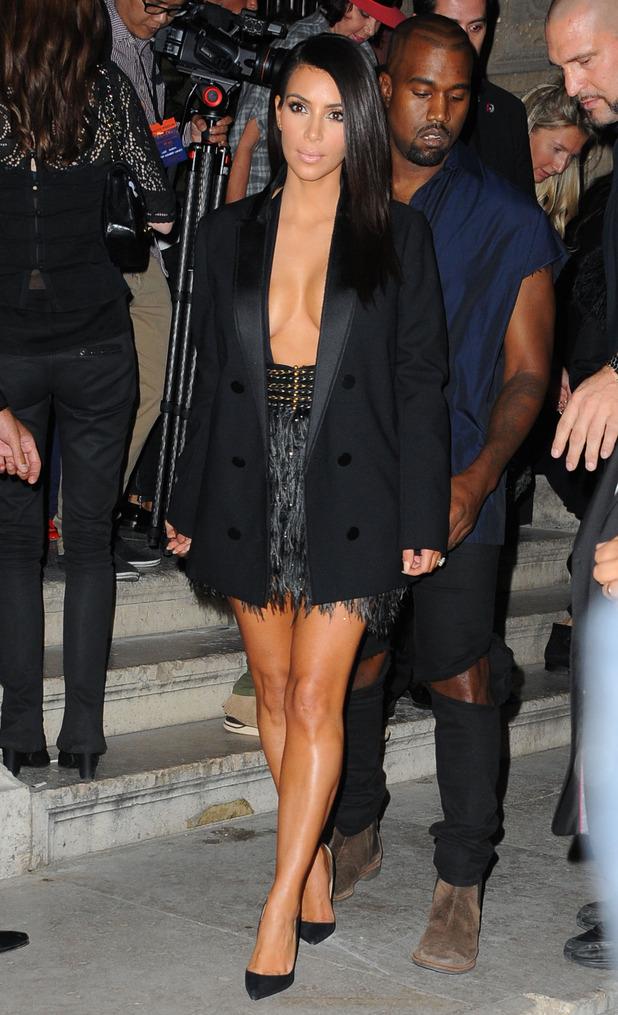 Kim Kardashian West and Kanye West attend the Balmain show at Paris Fashion Week - France - 25 September 2014