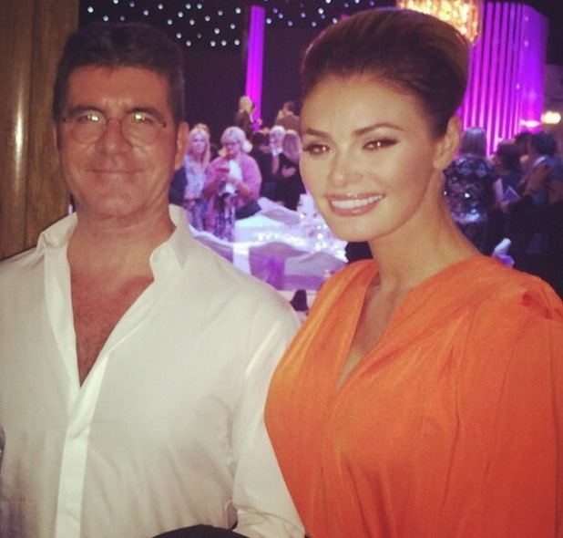 Chloe Sims meets Simon Cowell at the Pride of Britain Awards 2014, Grosvenor House Hotel, London 9 October