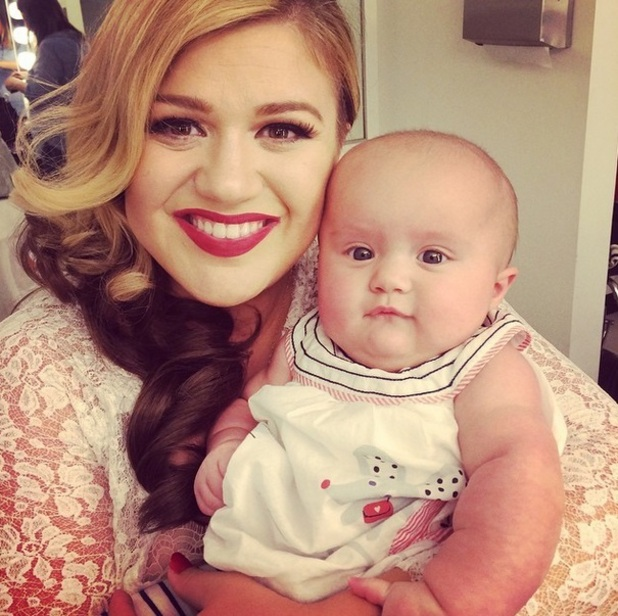 Kelly Clarkson visited by baby River Rose on set of Wrapped In Red music video, October 2014