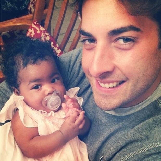 TOWIE's James 'Arg' Argent cuddles Danni Park-Dempsey's daughter Summer-Rose while babysitting - 5 October 2014