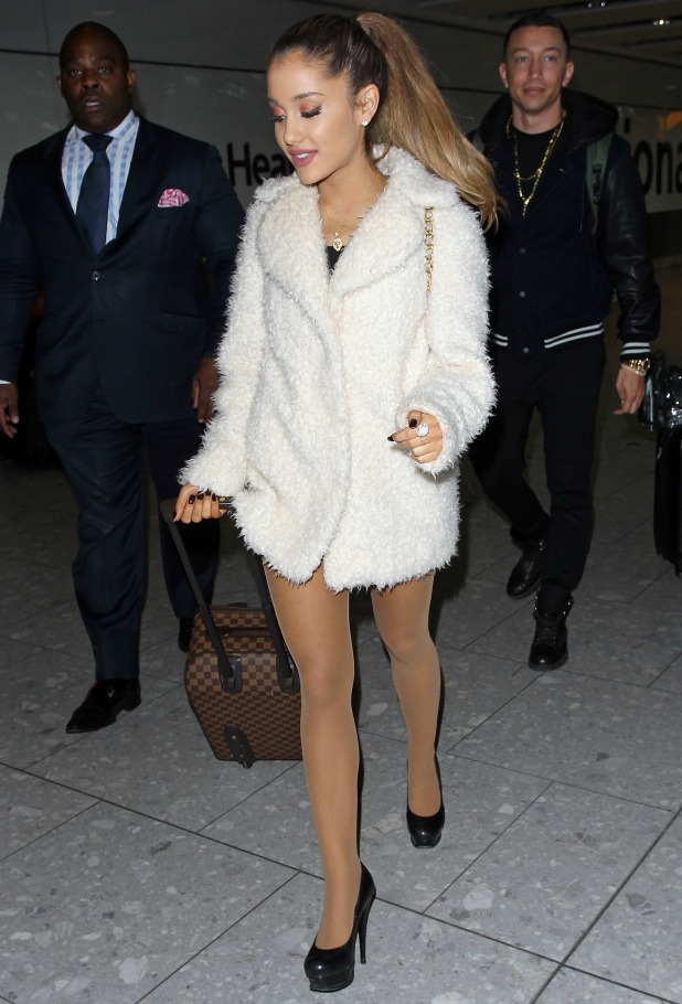 Ariana Grande seen arriving at Heathrow airport on October 7, 2014 in London, England. (Photo by Neil P. Mockford/GC Images)