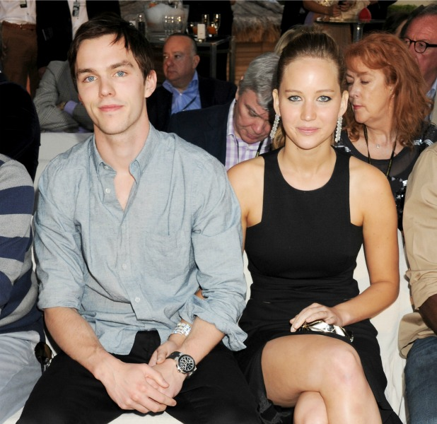 Nicholas Hoult (L) and Jennifer Lawrence attend a cocktail reception during Amber Lounge Fashion Monaco 2012 at Le Meridien Beach Plaza Hotel on May 25, 2012 in Monaco, Monaco
