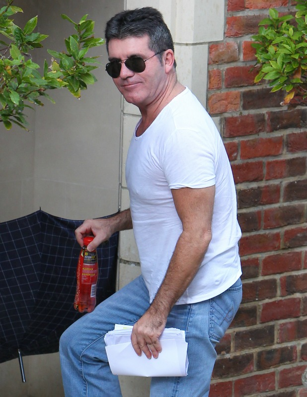 Simon Cowell arrives to visit the x Factor finalists at the house on his 55th birthday, 7 October 2014