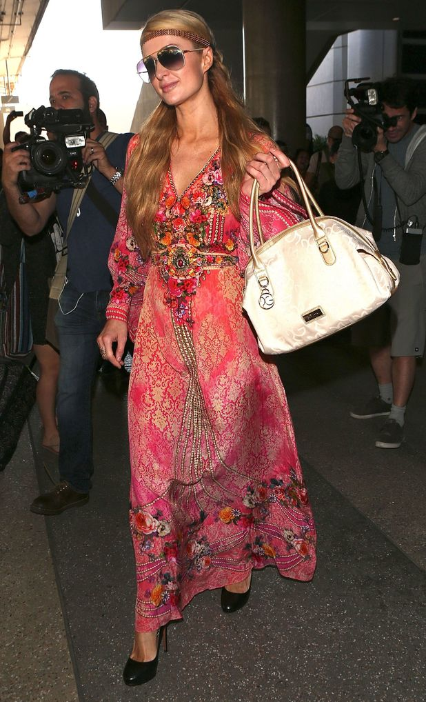 Paris Hilton wears a printed pink maxi dress while arriving at Los Angeles International Airport - 12 October 2014