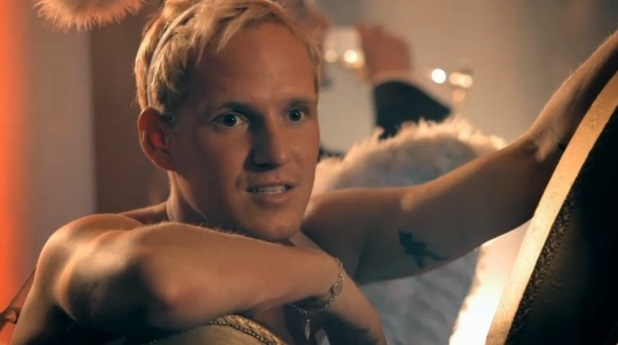 Made In Chelsea series 8, episode 1. Aired: Monday 13 October 2014. Jamie Laing watches on as Oliver Proudlock speaks to Lucy Watson at Spencer Matthews' party.