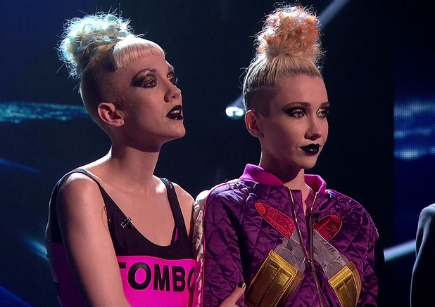 Blonde Electra wait to hear if they had made it through to following week's show, on the results show of 'The X Factor'. Shown on ITV1 HD. 12 October 2014.