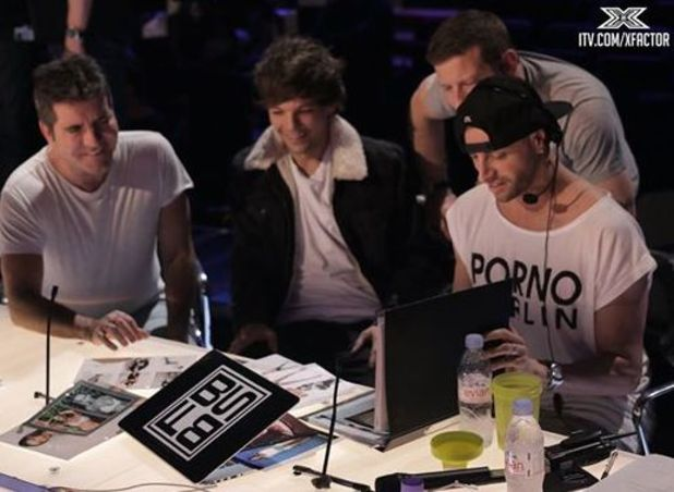 One Direction's Louis Tomlinson sits with Simon and Brian at rehearsal studios - 17 October.