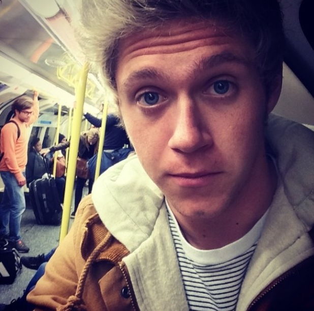 One Direction's Niall Horan takes tube selfie (13 October).