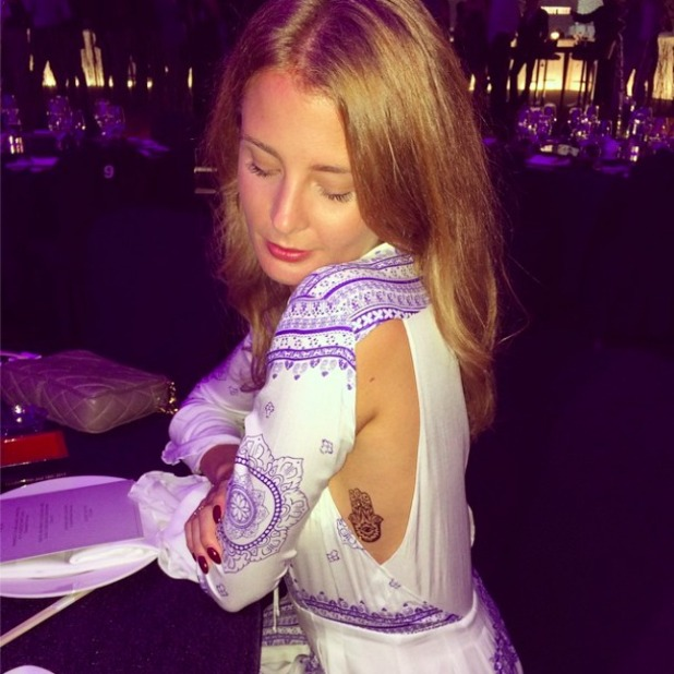 Millie Mackintosh shows off new tattoo in hippy dress, 17 October 2014