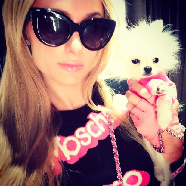 Paris Hilton dresses in Moschino Barbie collection while in New York, 17 October 2014
