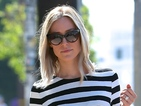 Kristin Cavallari stands out in monochrome stripey maxi dress in LA