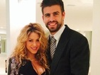 Pregnant Shakira beams as she shows off growing baby bump