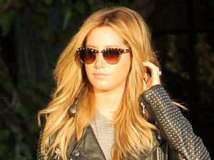 Ashley Tisdale teams super-ripped jeans with designer handbag in LA
