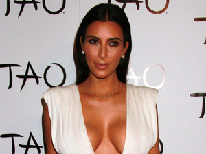Kim Kardashian West celebrates her birthday in a VERY revealing dress!