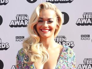 Rita Ora glam in plunging minidress before switching to denim overalls