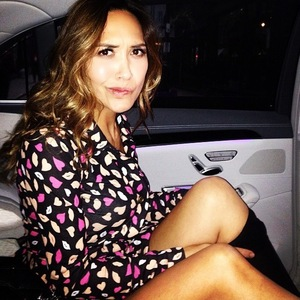 Myleene Klass gets ready for the MOBOs in back of her car 22 October
