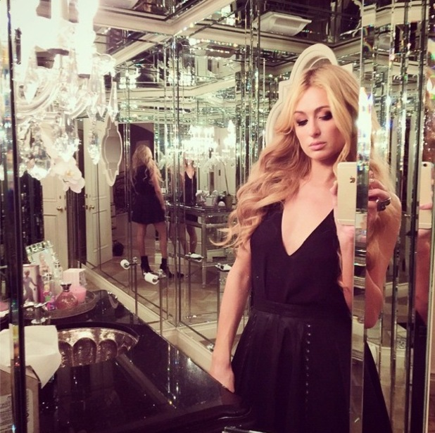 Paris Hilton takes a mirror picture before heading for a night out in Los Angeles, America - 22 October 2014