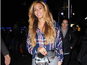 Beyoncé works leather pencil skirt and checked shirt - copy her look!