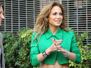 Jennifer Lopez gets it oh-so-wrong in green shirt and trousers