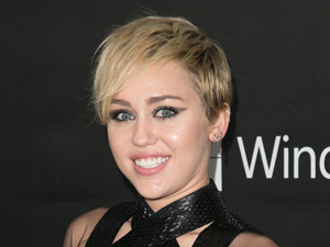 Miley Cyrus flaunts her cleavage in VERY revealing dress at amfAR Gala