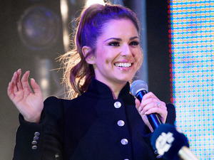 Cheryl switches on the Christmas lights in Oxford Street, London. 6 November.