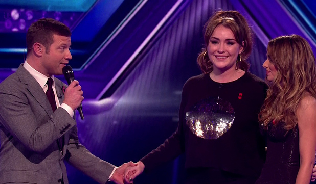 The X Factor - Dermot O'Leary speaks to Lola Saunders and Cheryl Fernandez-Versini after Lola was eliminated from the competition. 2 November 2014.