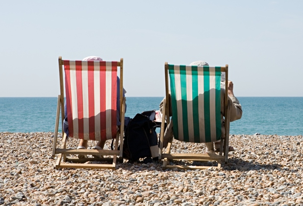 Couple in deck chairs on holiday