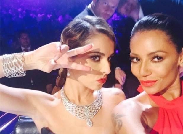 X Factor judge Mel B and Cheryl take selfie at the judging panel - 25 October 2014.