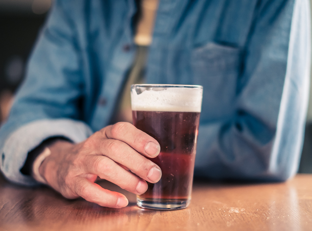 Man holding pint