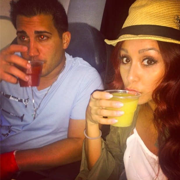 Snooki and fiancé Jionni LaValle on the plane heading to their respective bachelor and bachelorette parties, 7 November 2014