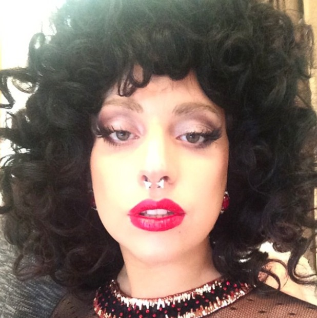 Lady Gaga in her dark Afro wig, 27 September 2014