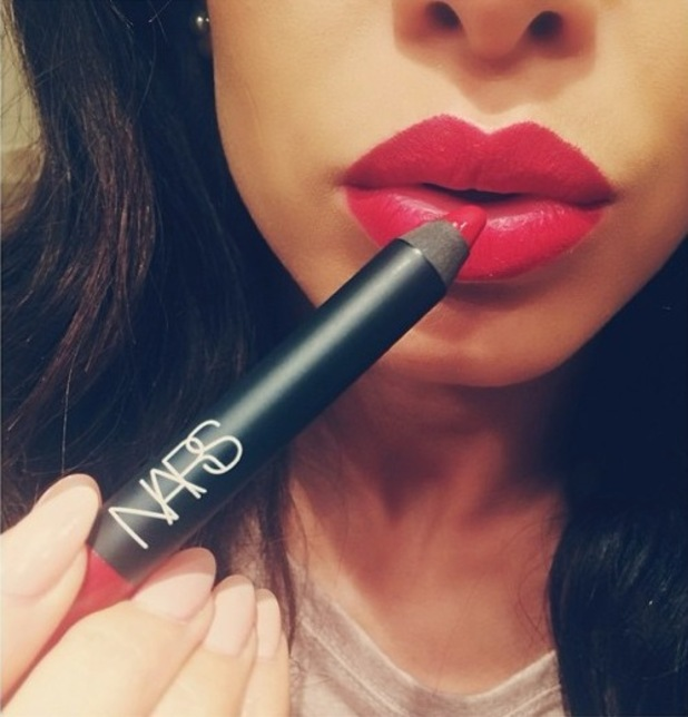 Danielle Peazer shows off her new favourite NARS red lip pencil - 6 November 2014