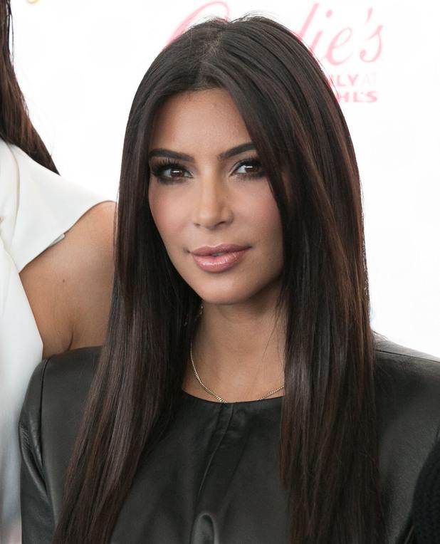 Kim Kardashian poses with sister Kendall Jenner