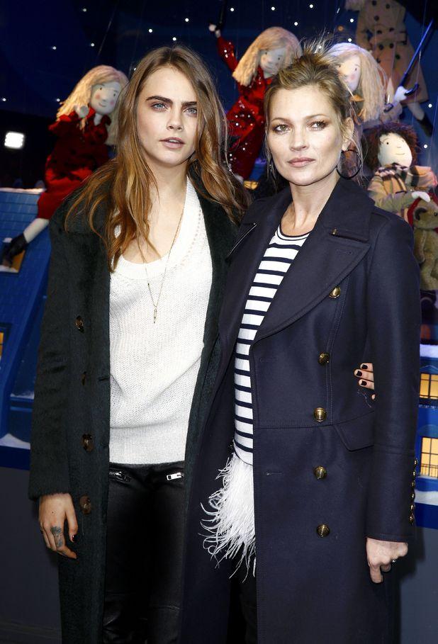 Kate Moss and Cara Delevingne at the Printemps Christmas Decorations Inauguration, Paris. 6 November 2014.