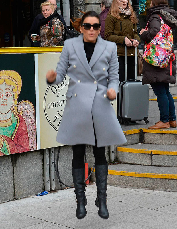 Eva Longoria enjoys taking jumping photos outside the 'Book of Kells' exhibition at Trinity College and grabbing a coffee at Costa Coffee on Dawson Street in Dublin, 3 November 2014
