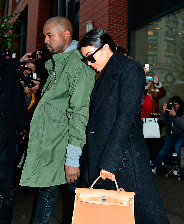 Kanye West and Kim Kardashian seen on the streets of Manhattan on November 6, 2014 in New York City. (Photo by James Devaney/GC Images)