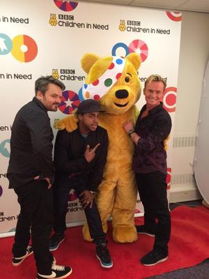 S Club 7's Bradley McIntosh, Paul Cattermole and Jon Lee pose with Pudsey Bear backstage at Children In Need, 14 November 2014