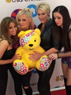S Club 7's Jo O'Meara, Hannah Spearitt, Rachel Stevens and Tina Barrett pose with Pudsey Bear backstage at Children In Need, 14 November 2014